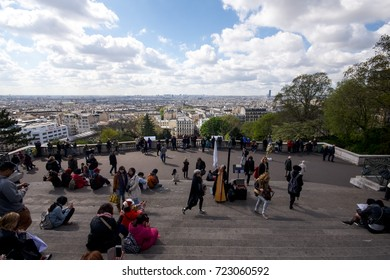 Paris, France - April 27, 2016 - People in the stairs of the Basilica of the Sacre Coeur in Montmartre with a panoramic view of Paris