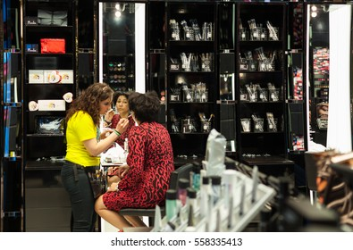 Paris, France -  April 28, 2013: Try to make up a tourist in Mac Makeup shop on Champs Elysee. MAC Cosmetics was founded in Toronto, Ontario, Canada by Frank Toskan and Frank Angelo in 1984.