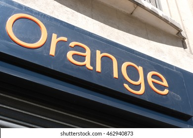 Paris, France - April 28, 2016: Orange insignia outside a store. Orange S.A., formerly France Telecom S.A., is a French multinational telecommunications corporation