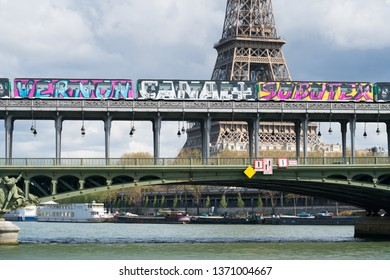 Paris, France - April 3, 2019: View of Eiffel tower and Bir Hakeim bridge