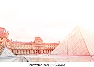 Paris, France - April 30, 2018: The Lourve Palace and Pyramid at sunset