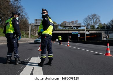 PARIS, FRANCE - April 5 2020 :  French police checkpoint on the Paris ring road to check whether drivers and passengers are in order to move around during the containment measures due to Covid-19.