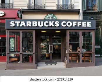 PARIS, FRANCE - APRIL 7, 2015: Starbucks Coffeehouse shop on the street. Starbucks is the largest coffeehouse company in the world, with 21,536 stores in 64 countries and territories.