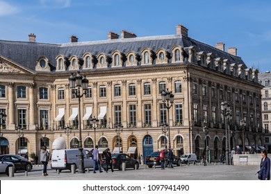 PARIS, FRANCE - APRIL 8, 2017: Place Vendome (1702), in centre Column of Vendome. Place Vendome serves today for prestigious establishments: Ritz hotel, Cartier, Rolex, Dior, Chanel, jewelers stores.