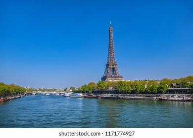 PARIS, FRANCE - APRIL 8, 2017: The picturesque Embankments of the Seine River in 15th arrondissement (arrondissment de Vaugirard) near famous Eiffel Tower.