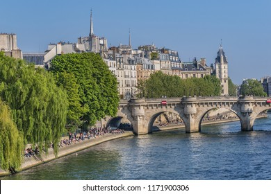 PARIS, FRANCE - APRIL 8, 2017: The Square du Vert-Galant is a small public garden located on the western tip of the Ile de la Cite. Square a favorite vacation spot young people.
