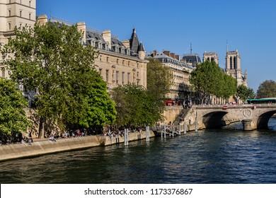 PARIS, FRANCE - APRIL 8, 2017: View picturesque embankment of the river Seine from Quai des Grands Augustins in Paris.