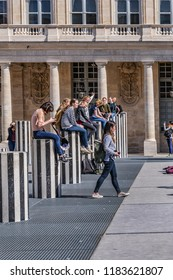 PARIS, FRANCE - APRIL 8, 2017: Paris Palais-Royal (Palais-Cardinal, 1639) was personal residence of Cardinal Richelieu. Paris Columns Buren (1985) - favorite place of Games and photography for youth.