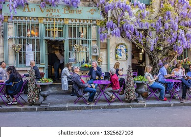 PARIS, FRANCE - APRIL 8, 2017: Au Viuex Paris d'Arcole restaurant at Narrow Street - rue Chanoinesse in heart of Paris, just a block from Notre Dame. It is one of oldest restaurants in Paris (1512).