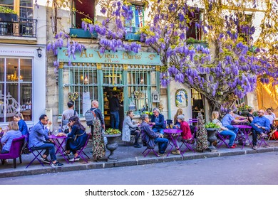 PARIS, FRANCE - APRIL 8, 2017: Au Viuex Paris d'Arcole restaurant at Narrow Street - rue Chanoinesse in heart of Paris, just a block from Notre Dame. It is one of oldest restaurants in Paris (1512).