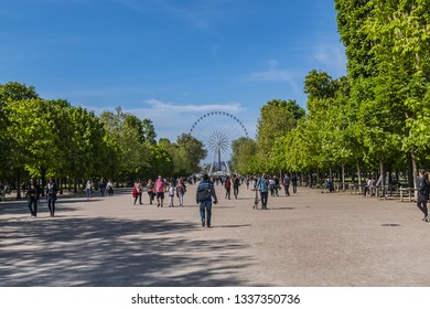PARIS, FRANCE - APRIL 8, 2017: Local and Tourist enjoy first sunny days in famous Tuileries garden. Jardin des Tuileries is a public garden located between Louvre Museum and Place de la Concorde.