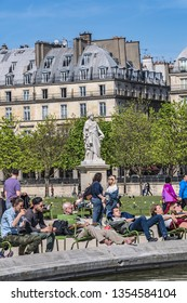PARIS, FRANCE - APRIL 8, 2017: Paris Tuileries garden (Jardin des Tuileries) - public garden created by Catherine de Medici in 1564. Local and Tourist enjoy first sunny days.