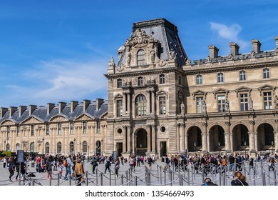 PARIS, FRANCE - APRIL 8, 2017: Paris Louvre Museum: main courtyard (Cour Napoleon) with Louvre Museum buildings. Paris Louvre Museum is one of largest and most visited museums worldwide.