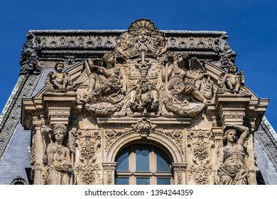 PARIS, FRANCE - APRIL 8, 2017: Paris Louvre Museum: Architectural fragments of Pavillon Colbert in main courtyard (Cour Napoleon). Paris Louvre Museum is one of largest, most visited museums worldwide