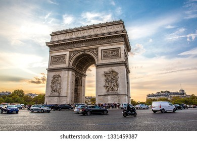 PARIS, FRANCE, ARCH OF TRIUMPH, September 2018. Landscape of this parisien landmark, street view from the roundabout at the blue/golden hour, local traffic, forbidden for pedestrians.