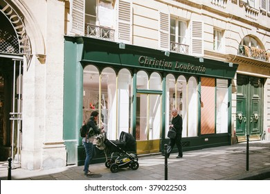 PARIS, FRANCE - AUG 18, 2014: Christian Louboutin luxury boutique shoe store facade. Christian Laboutin is a French luxury footwear and fashion designer whose footwear has incorporated shiny heels