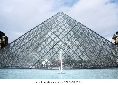 Paris, France - August 05, 2011: Glass Builiding Pyramid by the architect Pei Cobb Freed at Louvre Museum, which is one of most famous museum with huge collection of art objects in the world.