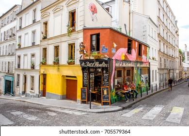 PARIS, FRANCE - August 07, 2017: Small restaurant Le Petit Moulin on the street at Momartre district in Paris