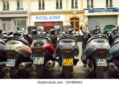 PARIS, FRANCE - AUGUST 09, 2015: modern and vintage motorbikes parked in the street of Paris. Paris, aka City of Love, is a popular travel destination and a major city in Europe