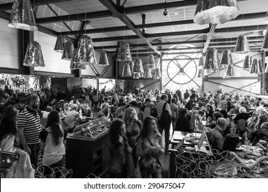 Paris, France - August 10, 2014: Restaurant with ancient clock window in Orsay Museum is full with visitors and personnel, black and white photo