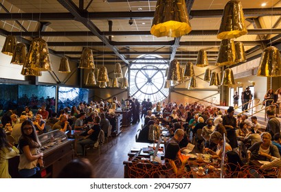 Paris, France - August 10, 2014: Restaurant with famous ancient clock window in Orsay Museum is full with visitors and personnel