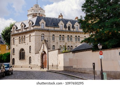 Paris, France - August 10, 2017. Chatolic church Carmel de Montmartre in Paris - old building of traditional medieval architecture situated on narrow cobblestone street on Monmartre hill.