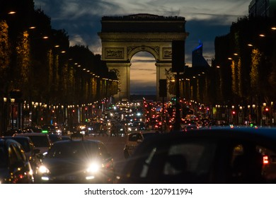 PARIS, FRANCE - AUGUST 11, 2018: Traffic in Champs Elysee after sunset  with Arch of Triumph in the background