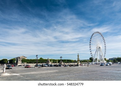 Paris, France - August 13, 2016: The ferris wheel on the Place de la Concorde. The place is one of the major public squares in Paris.