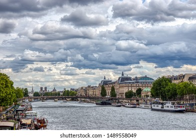 Paris, France - August 13 2019: Musee d'Orsay on a cloudy day. The Musee d'Orsay is a French impressionist art museum in Paris, on the left bank of the Seine.