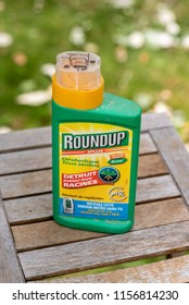 Paris, France - August 15, 2018 : Herbicide on a wooden table in a french garden. Roundup is a brand-name of an herbicide containing glyphosate, made by Monsanto Company.