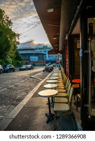Paris, France - August 15, 2018 : Typical view of the Parisian street with tables of brasserie (cafe) in Paris, France. Architecture and landmarks of Paris. Postcard of Paris