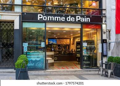 PARIS, FRANCE - AUGUST 15, 2020: Facade of a Pomme de Pain restaurant on the avenue des Champs-Elysées. Pomme de Pain is a French fast-food chain serving traditional French sandwiches and pastries