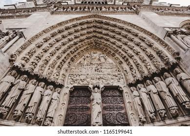 Paris, France - August 16, 2017. Portal of the last judgment - main entrance of Notre Dame de Paris. Central doorway depicting the Last Judgment and biblical scenes.