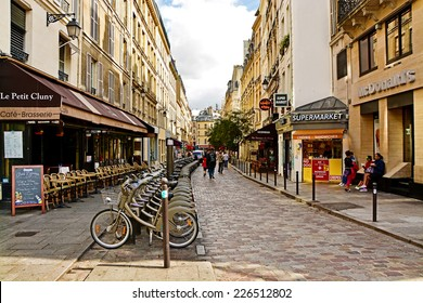 PARIS, FRANCE - August 18, 2014: Latin Quarter. Narrow street of Paris among old traditional parisian houses and cafe.
