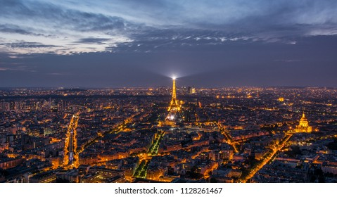 Paris / France - August 18, 2015: Paris evening skyline with the Eiffel Tower and les Invalides from the Tour Montparnasse