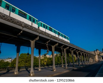 Paris, France - August 19, 2018 : Paris metro running on Pont de Bir Hakeim in Paris, France, a bridge for Metro.Metro is the 2nd largest underground system worldwide by number of stations (300).