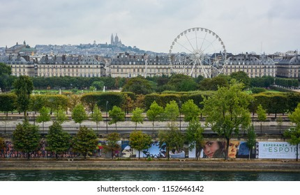 Paris / France — August 20, 2015: a beautiful panoramic view of Paris from Musée d'Orsay with the Seine, Tuileries Garden (Jardin des Tuileries), rue Rivoli and Montmartre hill at a cloudy morning