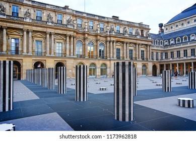 PARIS, FRANCE - AUGUST 20: Daniel Buren column in Palais-royal. In 1986 Daniel Buren created Les Deux Plateaux in the courtyard of the Palais-Royal in Paris, France on AUGUST 20, 2018