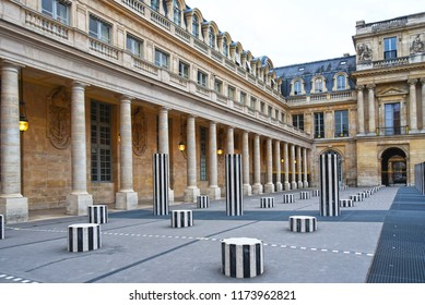 PARIS, FRANCE - AUGUST 20: Daniel Buren column in Palais-royal. In 1986 Daniel Buren created Les Deux Plateaux in the courtyard of the Palais-Royal in Paris, France on AUGUST 20, 2018