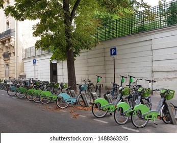 PARIS, FRANCE – AUGUST 2019: The French capital has set itself the goal of becoming a bicycle-friendly city. These include parking for public hire bikes and charging stations for electric bikes.