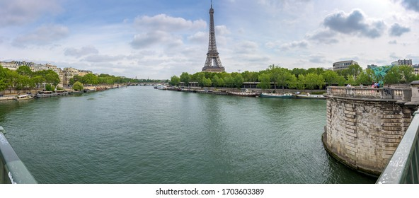 Paris, France. August 2019. View of the Eiffel Tower across the river Seine from the Pont de Bir-Hakeim bridge on a sunny summer day.