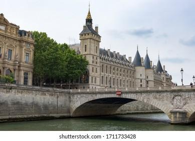 Paris, France. August 2019.  View of the Conciergerie building and watch tower (Tour de l'Horloge du palais de la Cité) and Pont au Change bridge on the Île de la Cité. On the left the Courthouse.