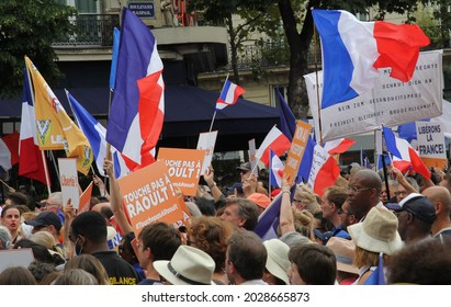 PARIS, FRANCE - AUGUST 21, 2021: Activists of the anti-Macron, anti-health passport policy during the manifestation at Place Denfert-Rochereau. The poster says Don't touch Raoult