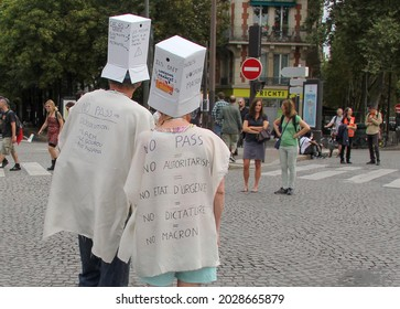 PARIS, FRANCE - AUGUST 21, 2021: Activists of the anti-Macron, anti-health passport policy during the manifestation at Place Denfert-Rochereau. The dress says No pass, No authoritarianism
