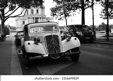 Paris, France - August 22th 2017 : White Citroën Traction parked in the street behind the Invalides.