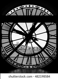 Paris, France - August 26, 2015: View through d'orsay museum clock tower of Sacre-Coeur Basilica in black and white.  Montmartre hill, Paris, France