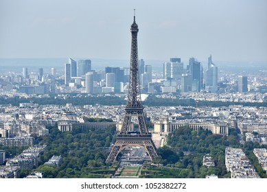 PARIS, FRANCE - AUGUST 27, 2017: The Eiffel Tower with the city skyline in the background on a sunny day observed from the observation deck of Tour Montparnasse.