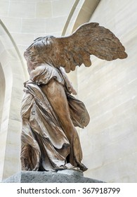 PARIS, FRANCE - AUGUST 28 2013: Winged Victory of Samothrace, also called Nike of Samothrace, marble sculpture exhibited in Louvre Museum