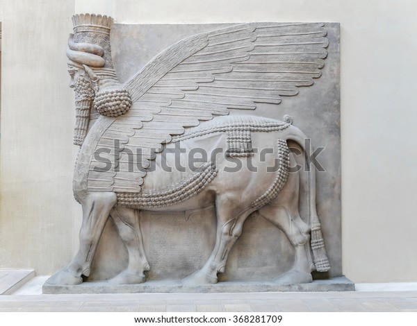 PARIS, FRANCE - AUGUST 28 2013: Relief in Cour Khorsabad courtyard - part of Ancient Mesopotamian history exhibited in Louvre Museum