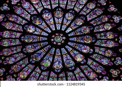 PARIS / FRANCE - AUGUST 28 2014: The North Rose window at Notre Dame cathedral. Stained glass